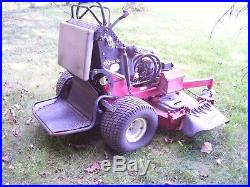 2010 Exmark Commercial Stand On Zero Turn Rider, 52 Cutting Deck 24hp